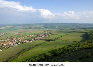 View of the village of Pavlov and the vineyards and fields in the area of Palava - South Moravia under a blue sky with clouds - Shutterstock ID 636616300