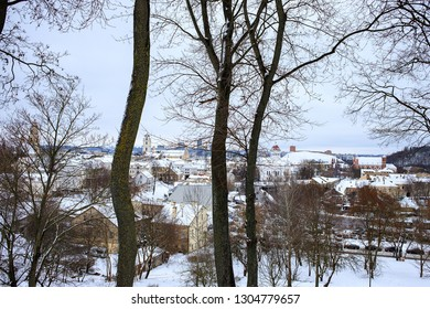 View of Vilnius, Lithuania in winter. Panorama with famous churches and istorical buildings: Bell Tower of St. John's Church, Gediminas' castle tower, gothic Church of St. Anne. Baltic states, travel.
