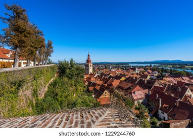 A view of the vineyards and the center of Ptuj city, church and old historical town of Ptuj, Slovnia. Blue sky, summer day in wine area of Ptuj, Ormoz and Jeruazalem.