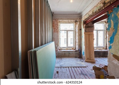 View the vintage room with fretwork on the ceiling of the apartment during under renovation, remodeling and construction.( remodeling of wall from gypsum plasterboard or drywall)