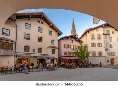 View of visitors enjoying drinks outside cafe on Hinterstadt, Kitzbuhel, Austrian Tyrol Region, Austria, Europe 1-5-2019