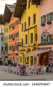 View of visitors enjoying drinks outside cafe on Vorderstadt, Kitzbuhel, Austrian Tyrol Region, Austria, Europe 1-5-2019