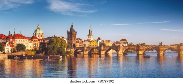 View of the Vltava River and the bridges shined with the sunset sun, Prague, the Czech Republic