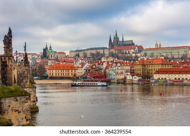 View of Vltava River, Old Town and St. Vitus Cathedral on background in Prague, Czech Republic.