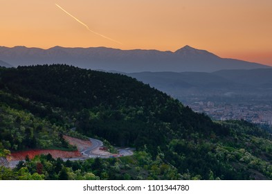 A view from Vodno mountain at Skopje with Shar mountain and Ljuboten peak in distance. Twilight sky.