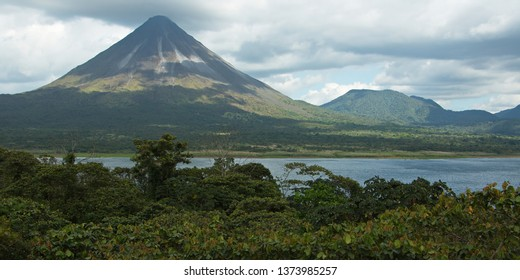 View of Volcan Arenal and Lake Arenal in Parque Nacional Volcan Arenal in Costa Rica