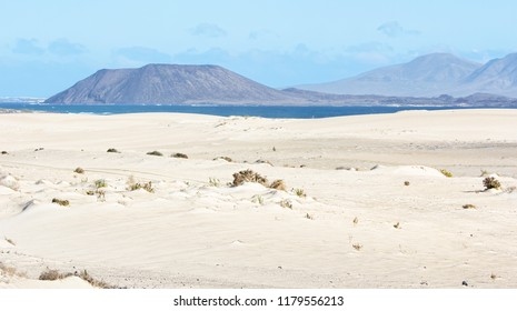 View of the volcano La Caldera on the small island of Los Lobos as seen from the dunes of Corralejo in the north east of Fuerteventura.