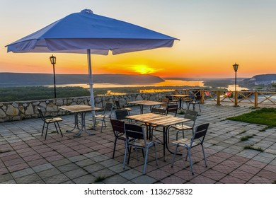 View of the Volga River from an observation platform near Samara, sunset over the Zhiguli Mountains. Summer cafe on the viewing platform.