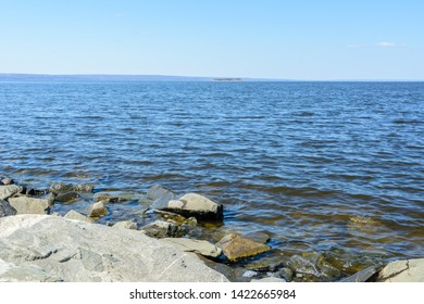 View of the Volga River from the Presidential Bridge in the city of Ulyanovsk. The widest place on the Volga River. Island on the Volga River. Sunny day.