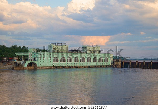 View of the Volkhov hydroelectric station June cloudy in the evening. Volkhov, Russia