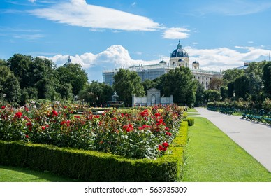 A view of Volksgarten park with flowering red roses in front of Hofburg, Vienna, Austria.