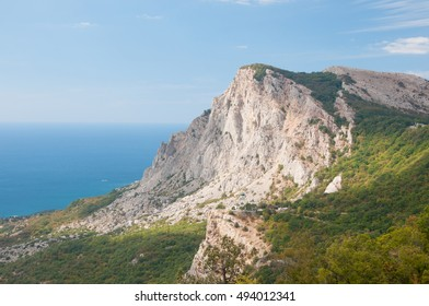View of Voskresenskaya church standing on Red Rock cliff in the morning sunlight, southern Crimea, Russia