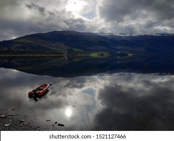 View in the Voss lake at autumn with sun and clouds