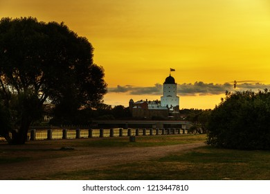 View of Vyborg castle at sunset, Vyborg Bay, Leningrad Oblast, Russia. August 2018. Tower in rays of setting sun.