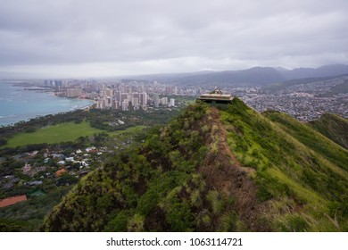 View of Waikiki Beach and the downtown area with tall buildings as seen from the summit of the Diamond Head Hike and trail system in Oahu Hawaii.