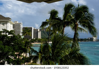 A view of the Waikiki shore line on a cloudy day.