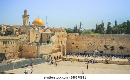 View of the Wailing Wall and on the gold-plated Dome Rock Al-Aqsa, Temple Mount, minaret, Jerusalem. Israel