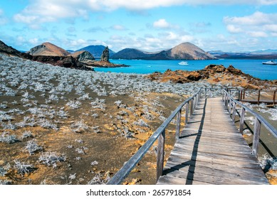 View of walkway on Bartolome Island with Pinnacle Rock in the background in the Galapagos Islands in Ecuador