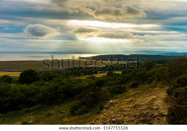 The view from Warton Craag over Morecambe Bay with storms building on the horizon.