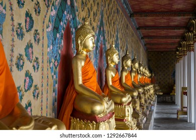 The view of Wat Arun ordination hall buddhist statues. Wat Arun or temple of the dawn is a famous temple in Bangkok, Thailand