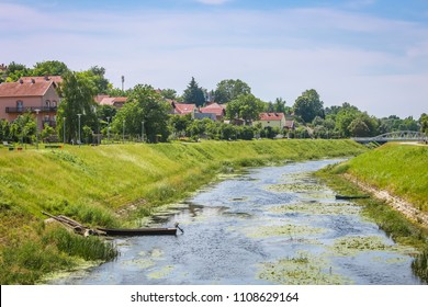 A view of the water channel of river Vuka with with motor boat in Vukovar, Croatia.