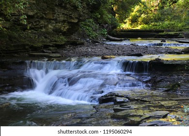 View of water falls along the Gorge Trail on the Stony Brook River in Stony Brook State Park, Dansville, New York.
