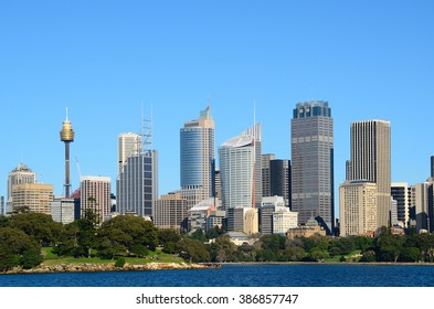 View from water on the sydney cbd with sydney tower and skyscrapers and royal botanic garden with tourists