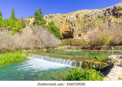 View of a water stream, with the remains of the Shrine and Cave of Pan in the background, in the Hermon Stream (Banias) Nature Reserve, Upper Galilee, Northern Israel