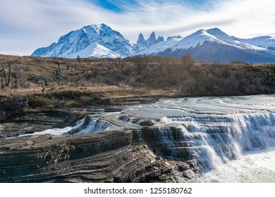 View of waterfall and granite towers at Torres del Paine national park of Chile