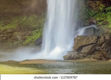 view of waterfall hitting and splash on the surface of hard rocks, Huay Luang Waterfall (Namtok Bak Tao), Phu Jong Na Yoi National Park, Ubon Ratchathani, isan, Thailand