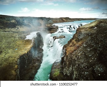 view of the waterfall from the quadrocopter from above, a beautiful landscape at sunset. Iceland.