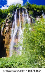 View of the waterfall under the blue sky, in Croatia