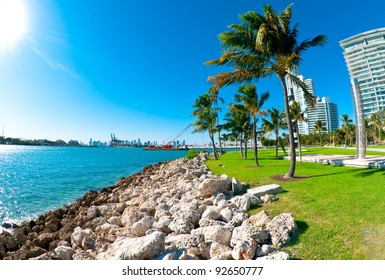 View of waterway used to enter Miami Seaport with city in the background and recreational park at the side