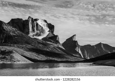 A view of Weeping Glacier on Mount Breadablik with Thor Peak in the background in Akshayuk Pass, Nunavut