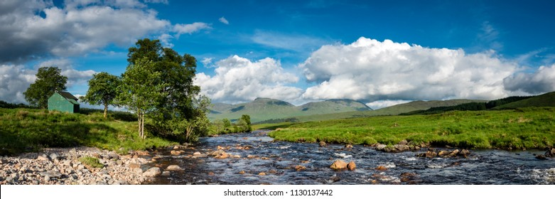 view of the west highland way in the highlands of scotland on a bright blue summer's day