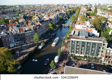 View from the Westerkerk to the Anne Frank House and Canal with boats in Amsterdam