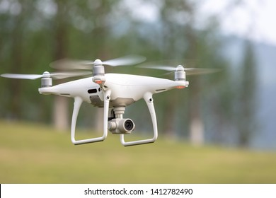 The View of a White Aerial Photographic UAV In the Air.