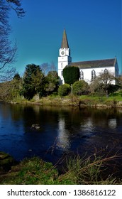 A view of the white church building on the banks of the river Earn in Comrie, Perthshire