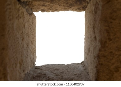 View of the white isolated background of the loopholes. The window in the wall.