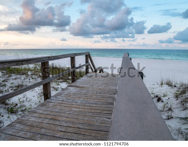 View of White Sand and Blue Ocean from Wooden Boardwalk