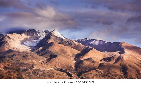 View of the wilderness of the Tibetan Plateau. There is snow on the top of the mountain in summer.