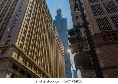 View of Wills Tower and traffic signals on North Adams Street, Downtown Chicago, Illinois, United States of America, North America 1-7-2019
