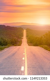 View of winding country road in Norway, Europe, Scandinavia at sunset. Auto travel.