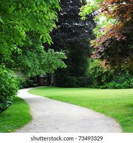 View of a Winding Path through a Tranquil Verdant Garden