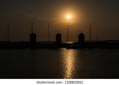 View of windmills in Mandraki harbor in City of Rhodes (Rhodes, Greece)
