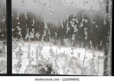 View of a window covered with a wet snow after snowstorm.