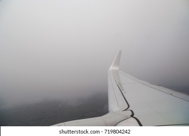 View from the window of the plane in bad non-flying weather. Turbulence in flight