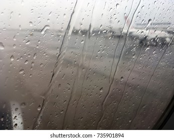 The view from the window of the plane on the runway, rainy weather