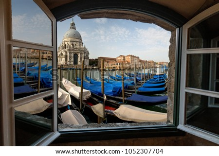 View from a Window of Venice Morning Gondolas, Canal and Basilica.