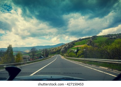 View from windscreen. Driving a car on mountain road